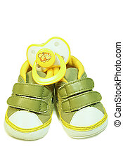 Baby's bootee and pacifier - Green baby's bootee and yellow ...