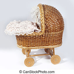 Babys carriage - retro pram with baby doll sleeping