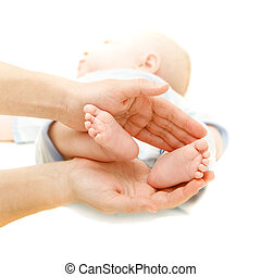 baby\'s feet in parent\'s hands over white