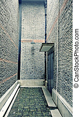 Backdoor of a big brick building in Shanghai, China
