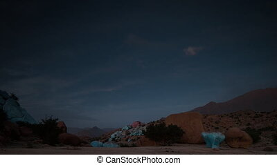 Back and forth timelapse video of painted rocks, Morocco - ...