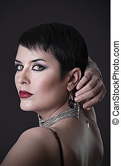Back elegant brunette woman with jewelry