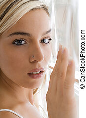 back light - a nice portrait of a cute blond girl with a...