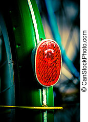 back light - red back light on a green bicycle