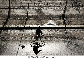 Back lit cyclist - Silhouette of back lit cyclist on bright...