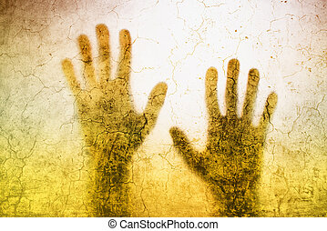 Back lit silhouette of trapped person hands behind matte...