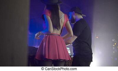 Back look of PJ and DJ legs dancing on the scene 4K
