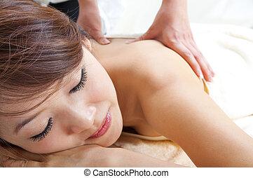 Back massage - Beauty and Spa - Asian Girl having a massage...