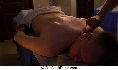 Back massage. Men's beauty salon.
