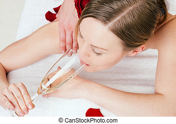 Back massage with sparkling wine