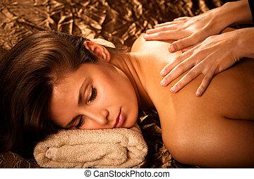 back massage - woman getting back  massage in spa salon