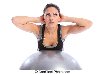 Back muscle exercise by woman on fitness ball