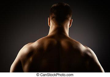 back muscles - Athlete bodybuilder man demonstrating his...