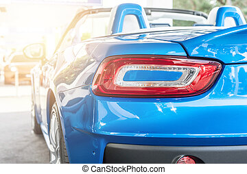 Back of a blue sport car in sunset
