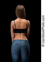 Back of a girl in blue jeans
