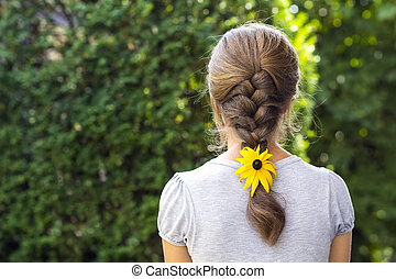 Back of a woman with flower in her hair