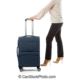 Back of businesswoman going in a travel and carry luggage isolated on white background