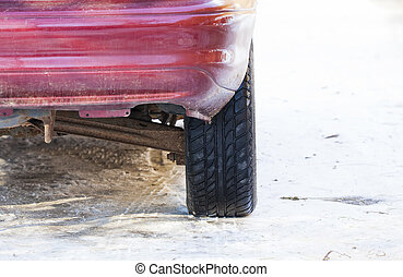 back of car with tire in the snow.