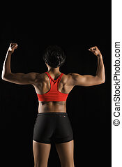 Back of muscular woman.