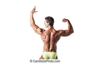 Back of muscular young man doing bodybuilding pose