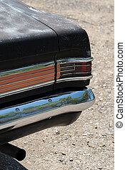 back of old vintage car with Taillight exhaust pipes