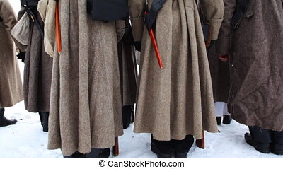 back of soldiers in uniform and with weapons of Russian army 19th century