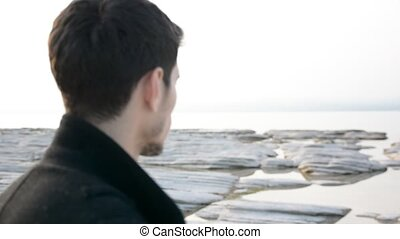 Back of the head of young man on a lake in a sunny
