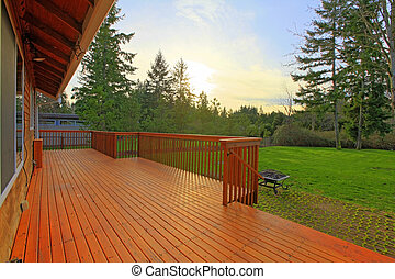 Spring sunset and back yard with deck