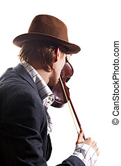 back of violinist playing the violin in hat