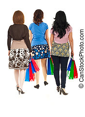 Back of walking women at shopping