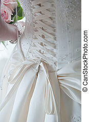 Back of wedding dress - Close-up image of the detailed laces...