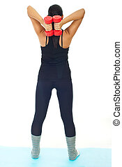 Back of woman doing exercises with dumb bell isolated on...