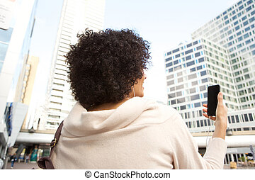woman using mobile phone in the city