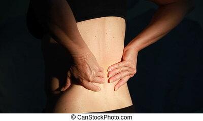 Back pain close-up