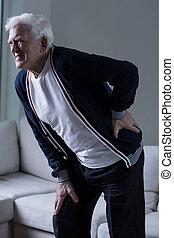 Back pain - Elderly man with sharp lower back pain