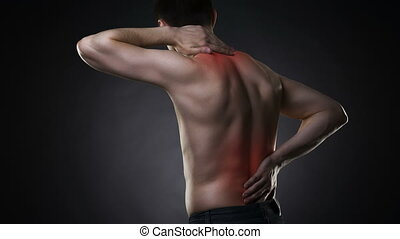 Back pain, man with backache on black background with red...