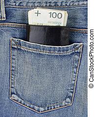 Back pocket of jeans with wallet and money - Back pocket of...