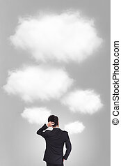 Back pose of a business person thinking with cloud and gray background, asian model