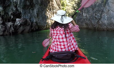 Back Rear Of Woman Kayaking In Beautiful Lagoon Action Camera View Of Girl Paddling On Kayak Boat