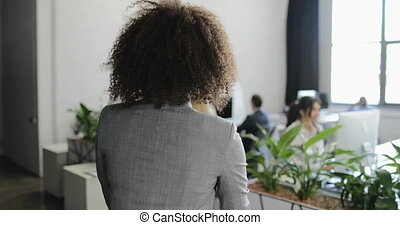 Back Rear View Of African American Business Woman Coming To...