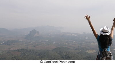Back Rear View Of Couple Of Tourists On Mountain Top Hold Raised Hands Enjoy Freedom Man And Woman Looking At Landscape