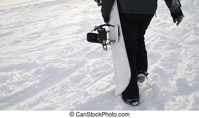 Snowboarder Walking Up on Hill for Skiing - Back Shot of...