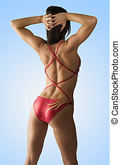 back side muscle - sexy girl in red costume showing her back...