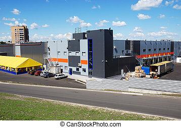 back side of big storehouse, truck loading
