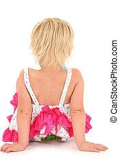 Back side of preschool girl on white background sitting.
