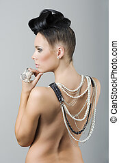 back side woman with hairstyle and jewellery