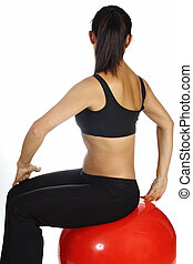 Back Stretch - A female fitness instructor demonstrates a...