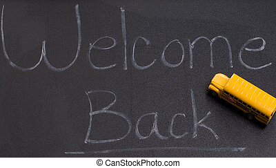 Back To School - A black board with the words welcome back,...