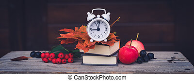 Back to school Alarm clock, maple leaves, apples, ashberries, September 1 concept banner