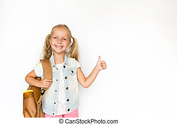 Back to school and happy time. Cute child with blonde hair on white background. Kid with backpack. Girl ready to study. Mockup, place for text, education concept
